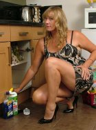 Hot Milf flashes her legs and stilettos in kitchen