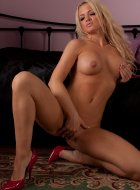 Stunning blonde strips off and plays with herself