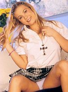 Teen tease in a plaid skirt and white panties