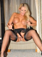 Busty blonde Milf strips off for fun in hotel room
