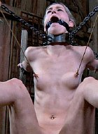 Calico Lane big tit babe chained naked in dungeon