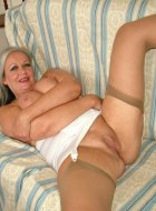 Busty Attractive granny in girdle and stockings