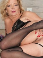 Blonde mature Karen Summer in stockings and heels