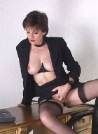 Sexy mature boss in her garter belt and stockings