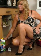 Kinky leggy Milf cleaning in some hot stilettos