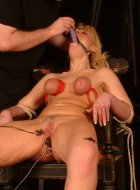 Blonde slavegirl bound and spanked in cage
