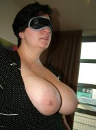 Busty mature BBW in stockings blindfolded and tied
